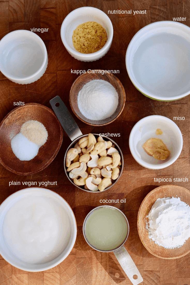 vegan mozzarella ingredients on a wooden cutting board