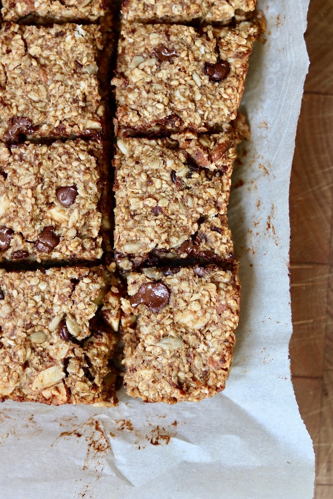 healthy oatmeal breakfast bars sliced on parchment paper