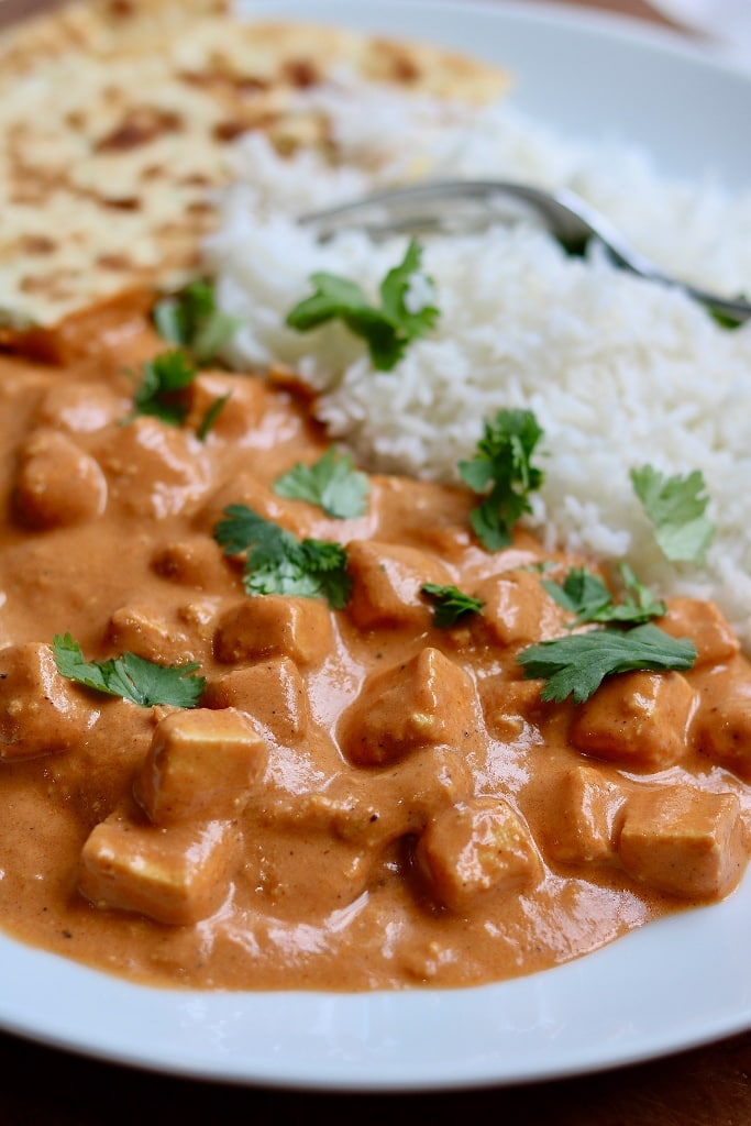 vegan butter chicken with rice on a white plate