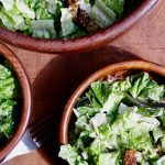 vegan caesar salad in three bowls