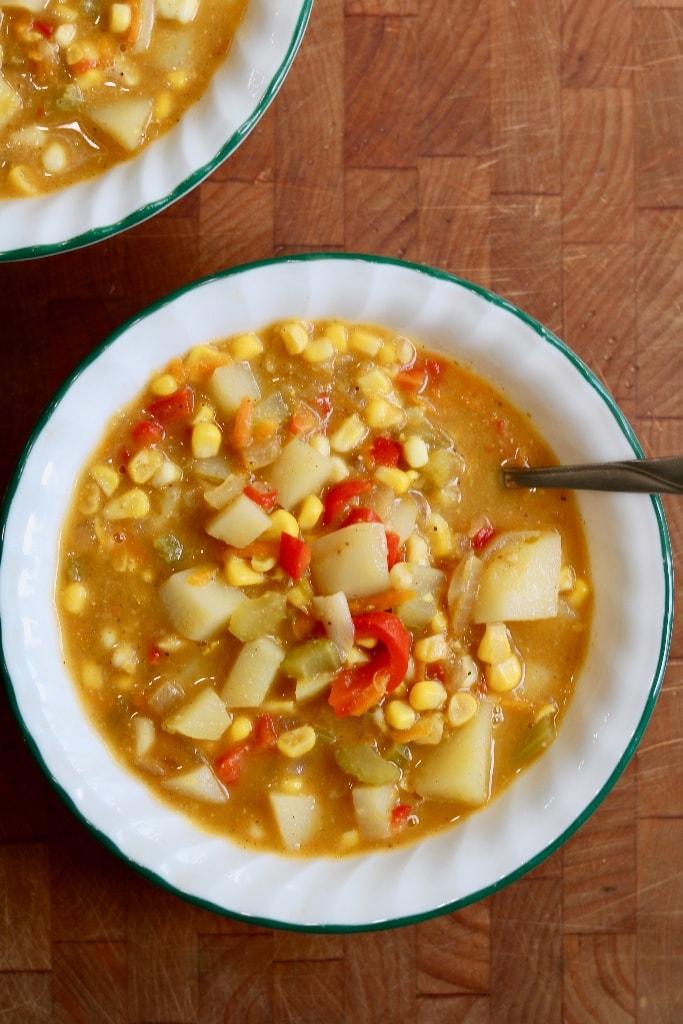 vegan corn chowder in a white bowl