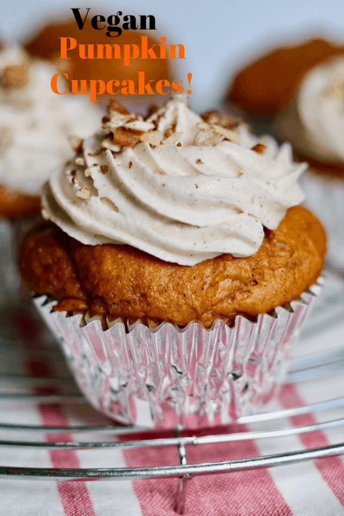 frosted pumpkin cupcake on a cooling rack