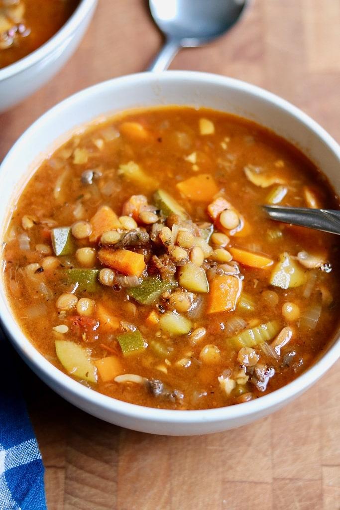 vegan lentil soup in a white bowl