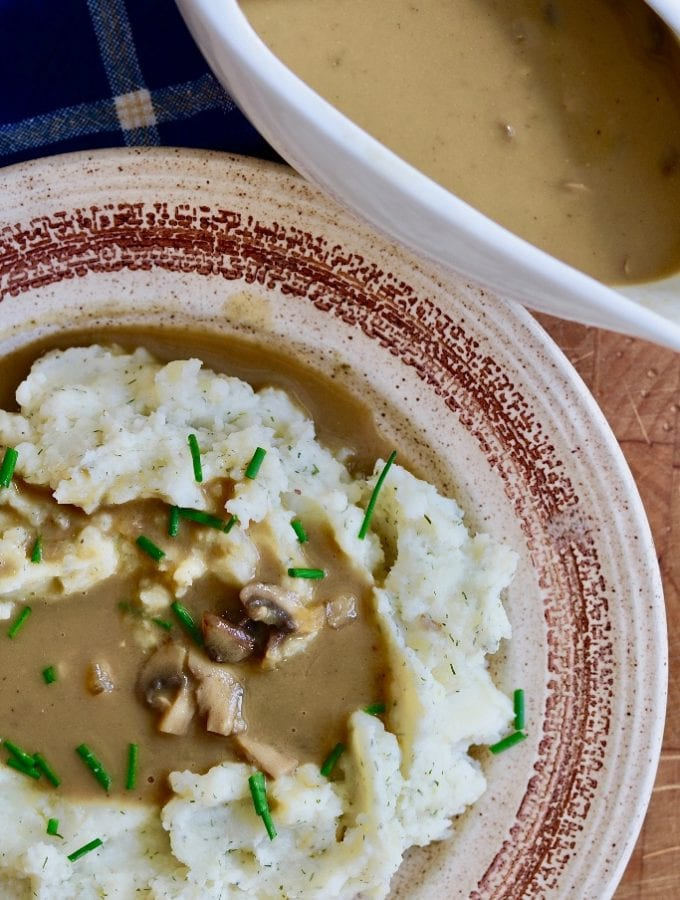 vegan mushroom gravy on top of mashed potatoes