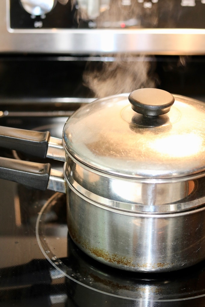 vegan turkey in steamer pot cooking on stove top