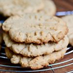 three vegan peanut butter cookies on a cooling rack