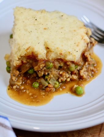 piece of vegan shepherd's pie on a white plate