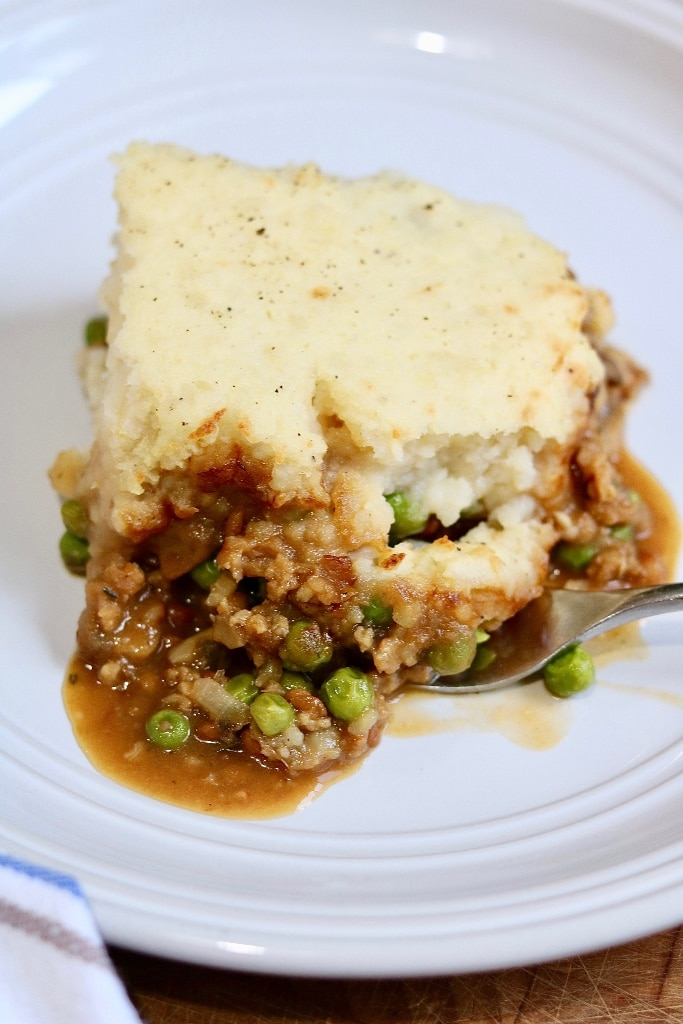 vegan shepherd's pie being scooped with a fork