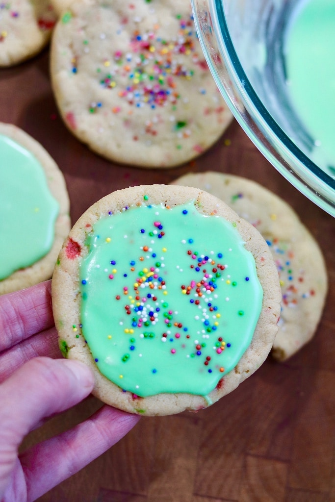 vegan sugar cookie decorated with green frosting