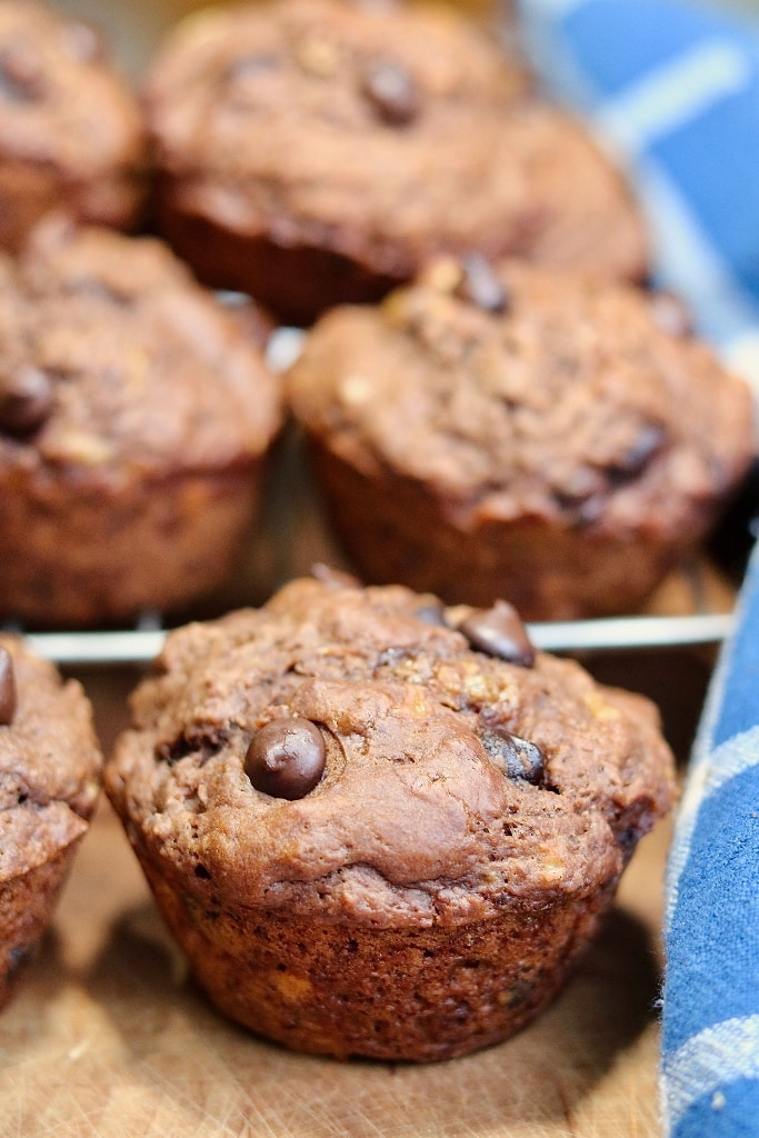 chocolate banana muffins on a wire rack cooling