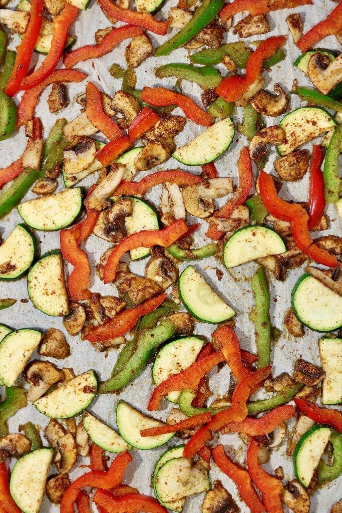 roasted vegetables for vegan quesadillas on a baking sheet