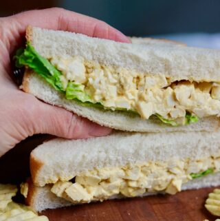 half a vegan egg salad sandwich being held