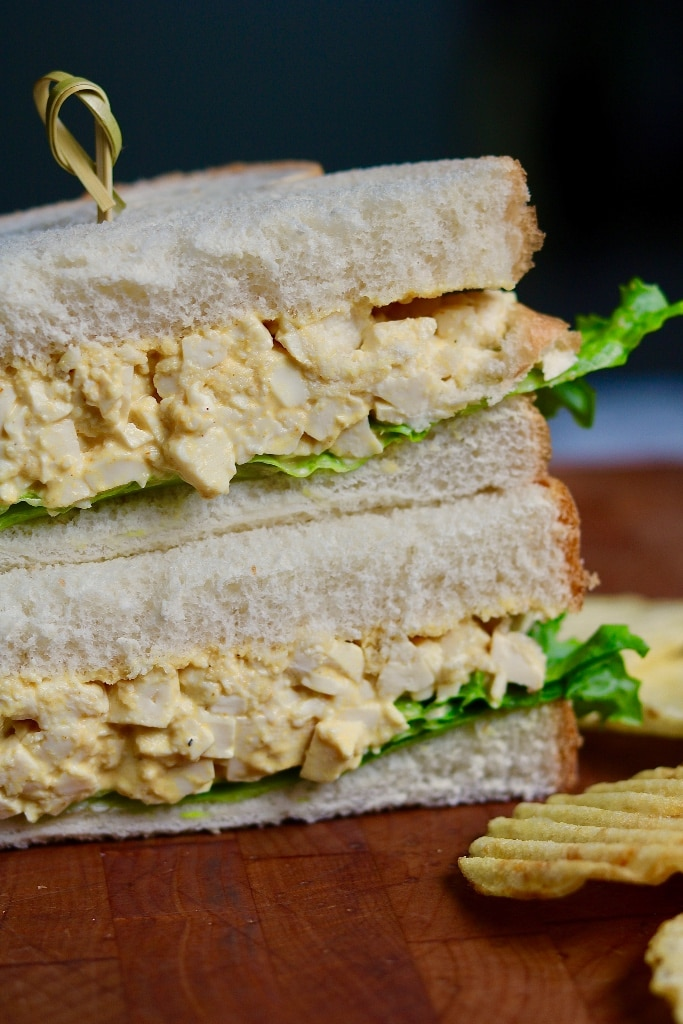vegan egg salad sandwich cut in half and stacked