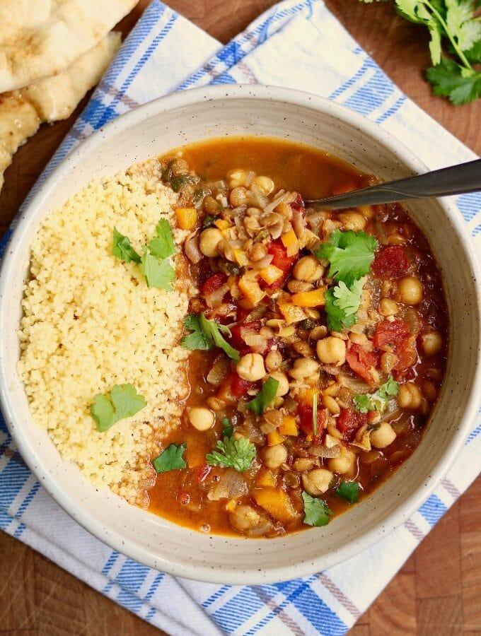moroccan stew in a white bowl with couscous