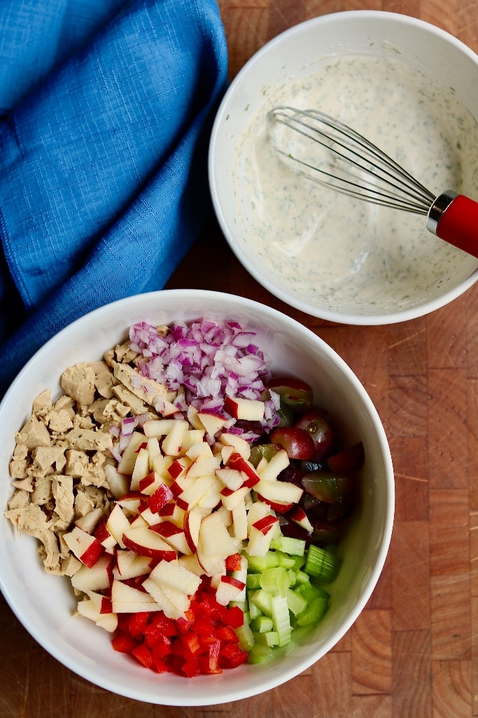 chicken salad ingredients in a large bowl and salad dressing in a small bowl