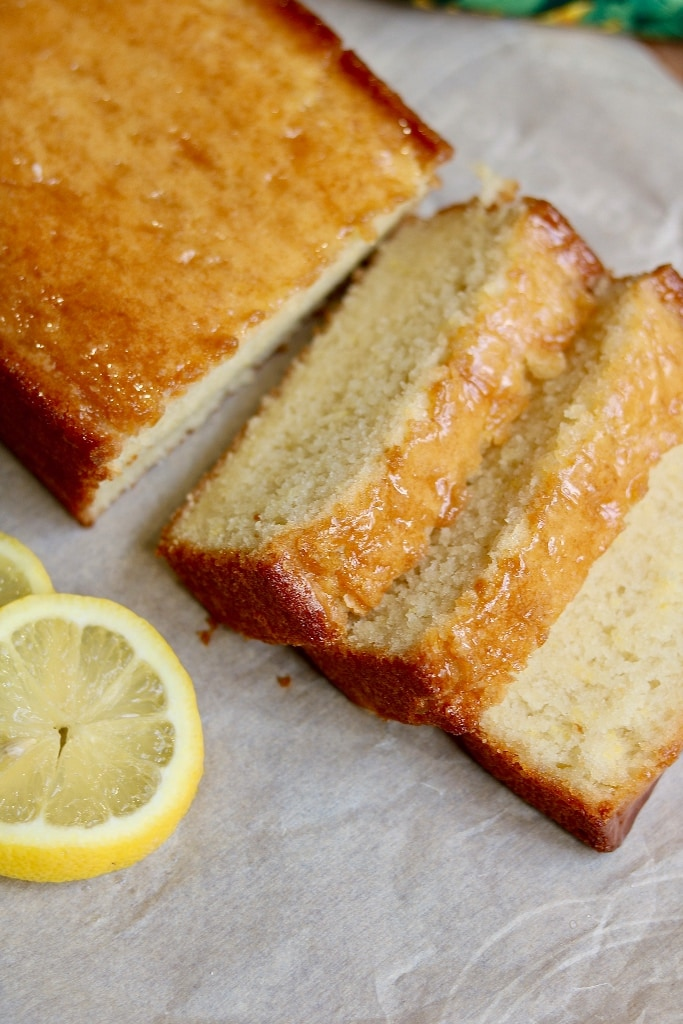 vegan lemon loaf with three cut slices