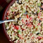 vegan macaroni salad in a wooden bowl with a spoon