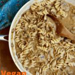 vegan mushroom stroganoff in a skillet with a wooden spoon