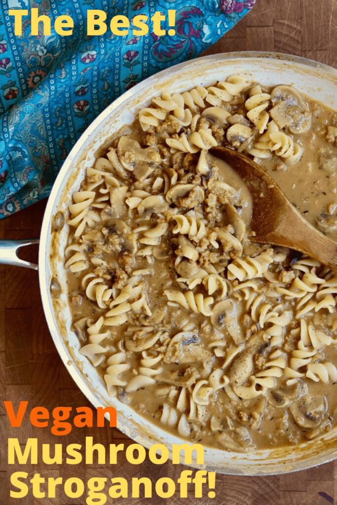 vegan mushroom stroganoff in a skillet with a wooden spoon