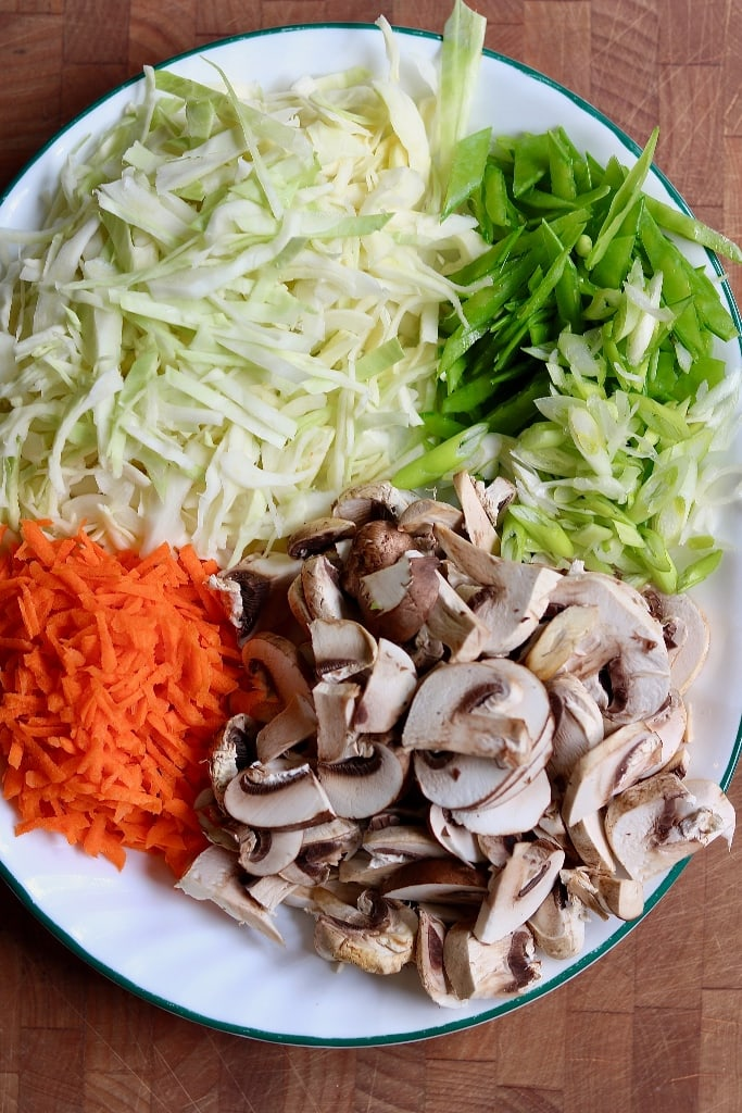 prepped vegetables on a large plate for teriyaki noodles recipe