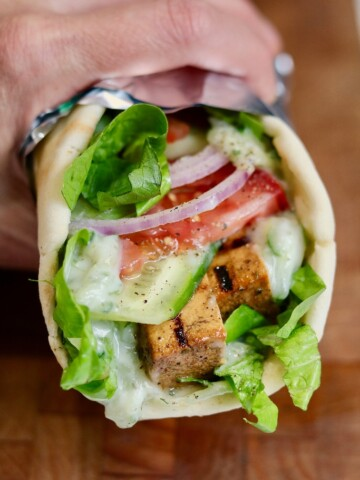 vegan gyro being held