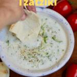 pita being dipped into vegan tzatziki sauce