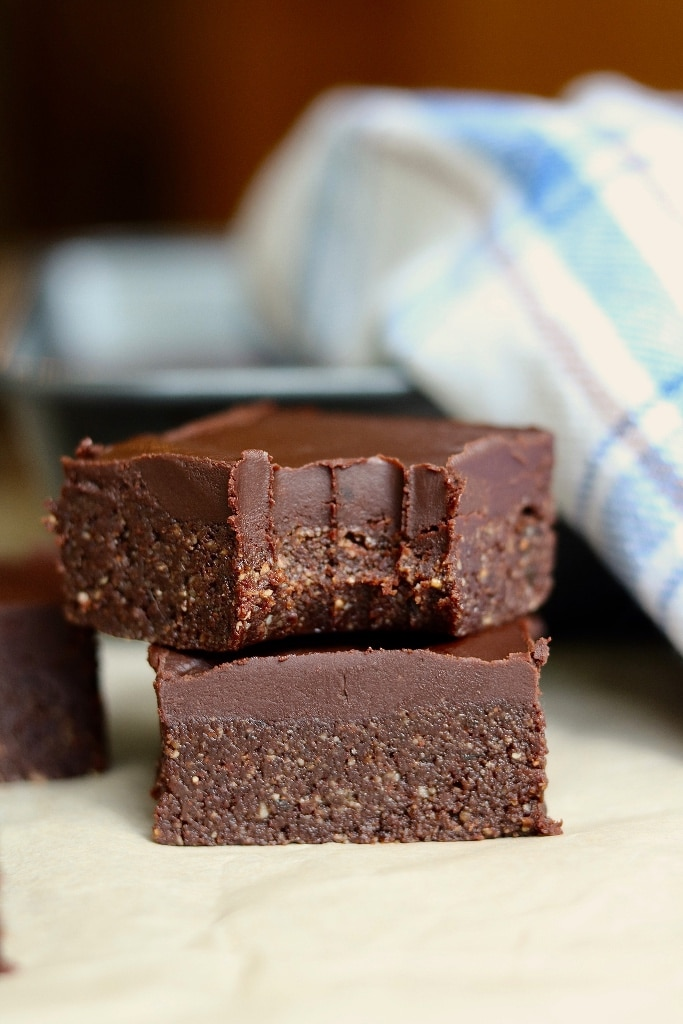 two brownies stacked on parchment paper