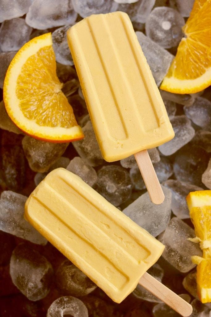 orange creamsicles on ice with orange slices