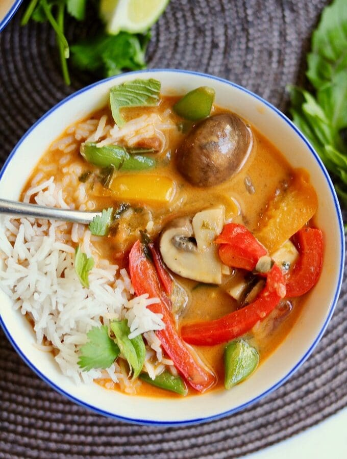 thai red curry vegetables Iin a white bowl with rice