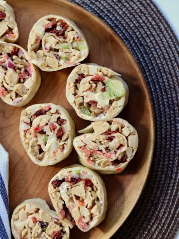 overhead view vegan pinwheels sliced on a platter