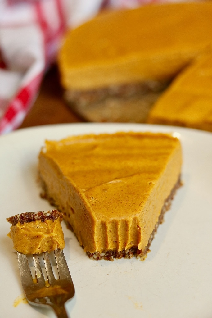 a slice of no bake pumpkin cheesecake on a plate with a fork
