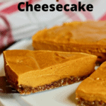 slice of vegan pumpkin cheesecake on a cake platter