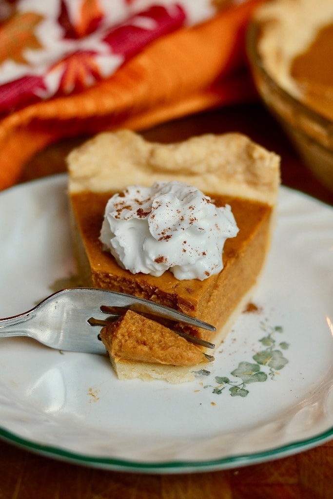 slice of pumpkin pie with a fork