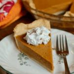 slice of vegan pumpkin pie on a white plate