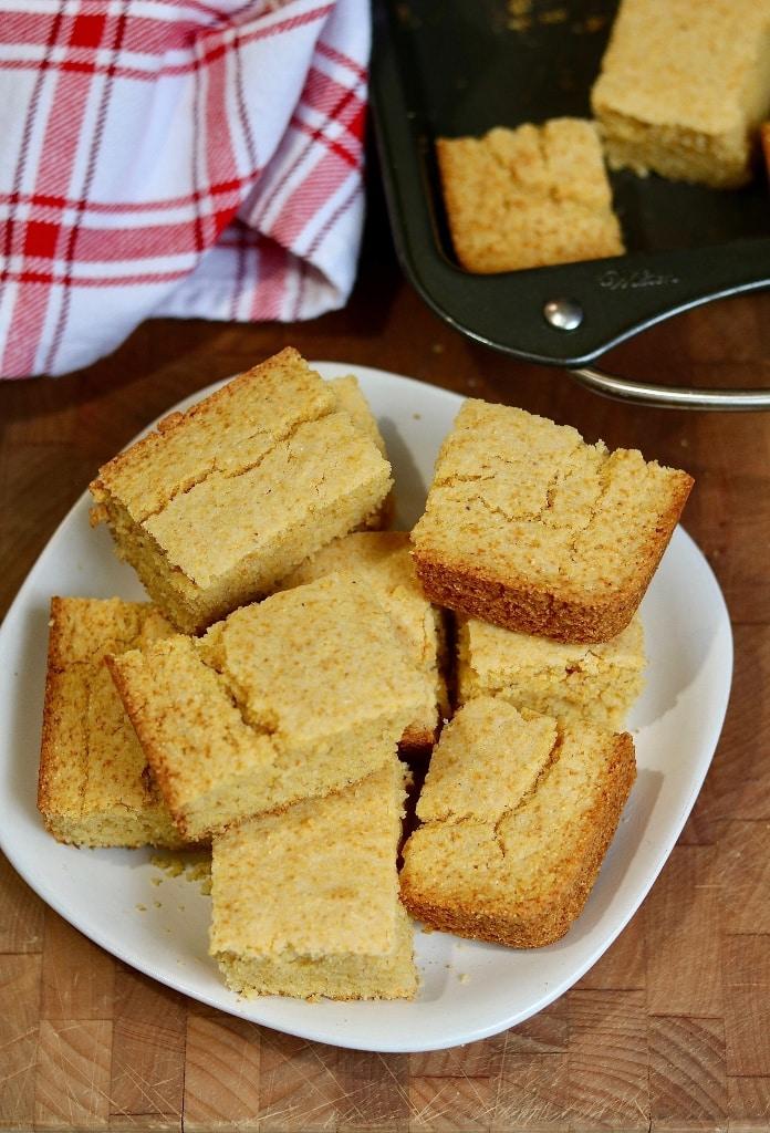 vegan cornbread sliced into squares on a plate