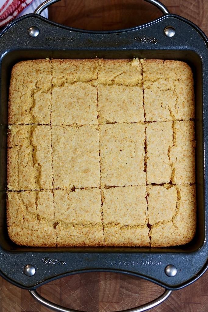 vegan cornbread sliced into squares in baking pan