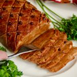 vegan ham roast on a platter sliced