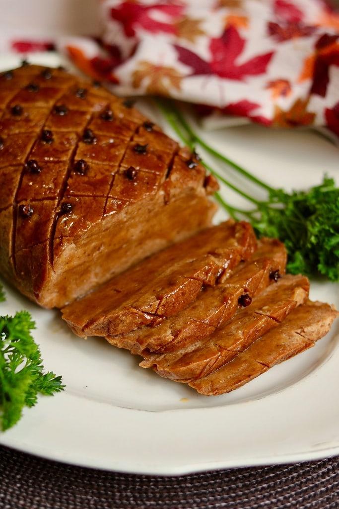 seitan ham sliced on a serving plate