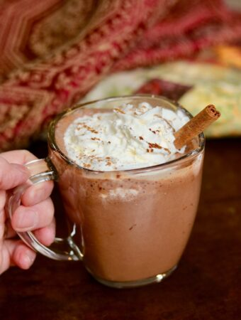 a cup of vegan hot chocolate with coconut whipped cream