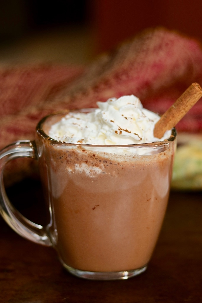 a cup of hot cocoa with vegan whipped topping