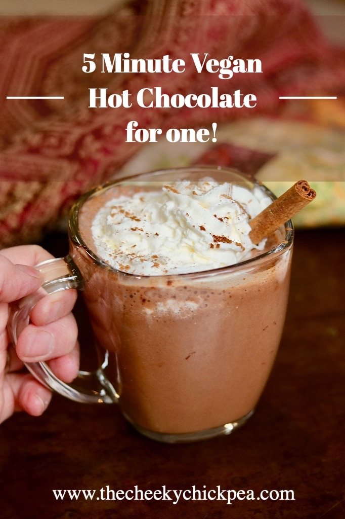 a mug of vegan hot chocolate with coconut whipped cream