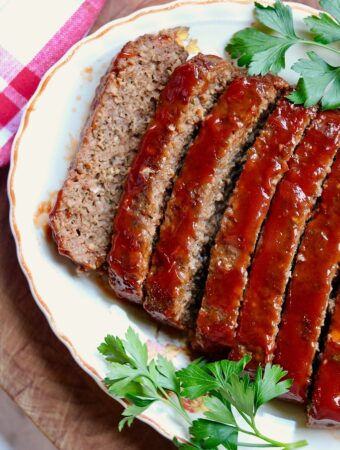 vegan meatloaf sliced on a platter