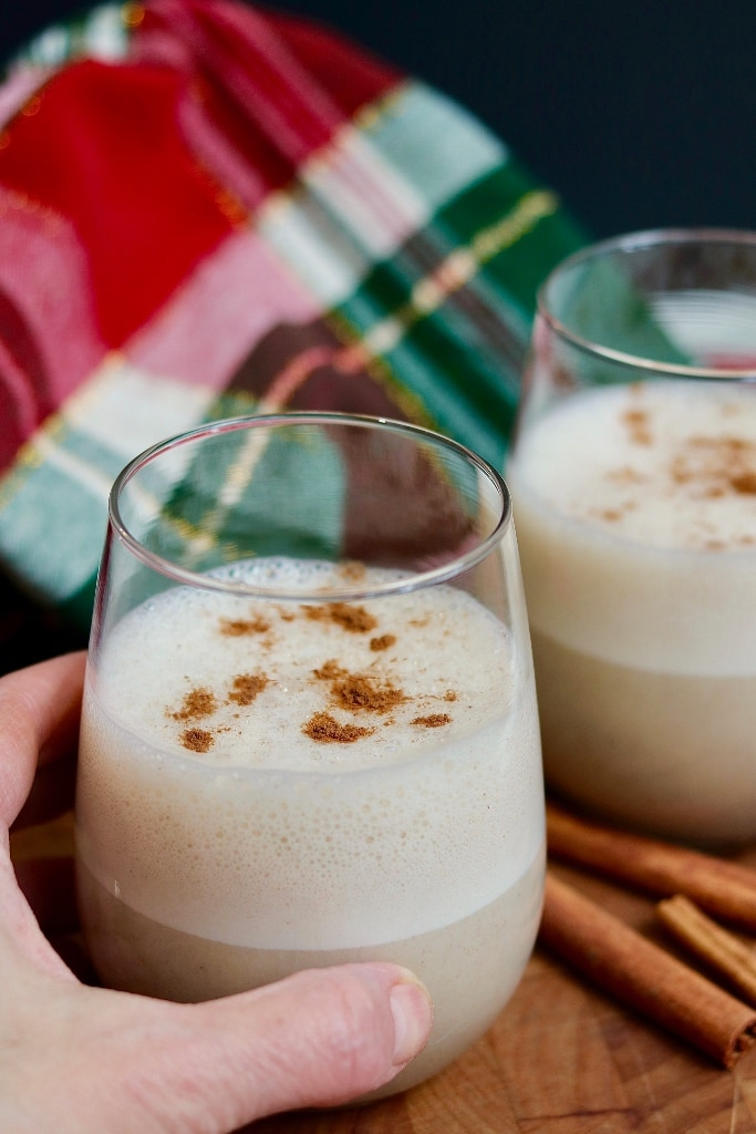 a glass of eggnog being held