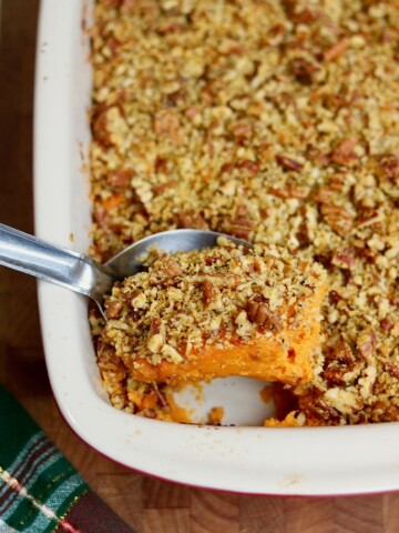 vegan sweet potato casserole being dished out with serving spoon