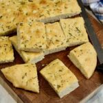focaccia bread sliced on a cutting board