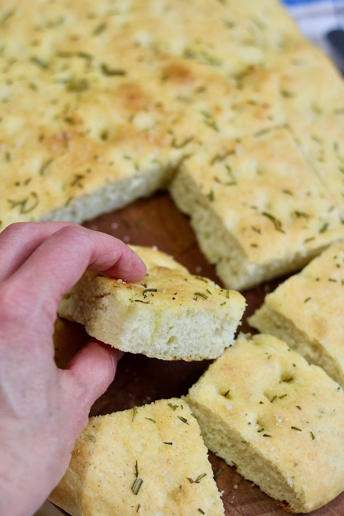 piece of sliced focaccia being picked up