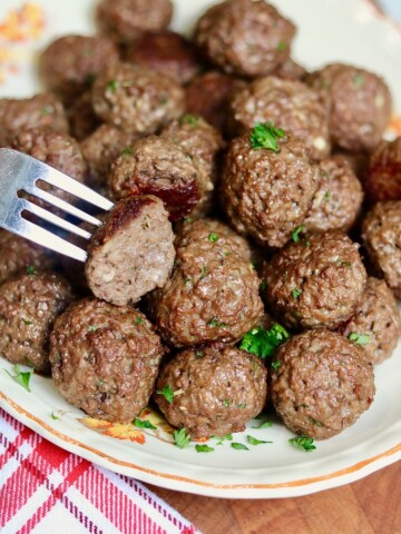 vegan meatballs on a platter with a fork