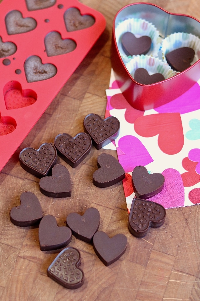 homemade chocolates on a table with candy mold