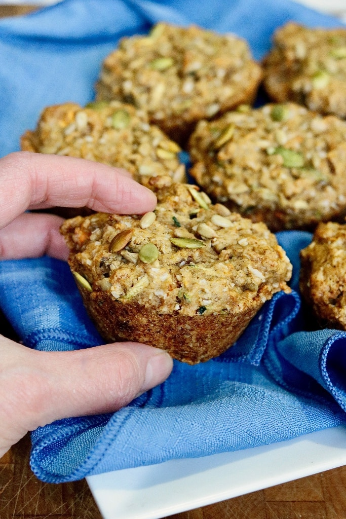 morning glory muffin being taken from a plate