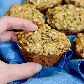 morning glory muffin being taken off of a plate